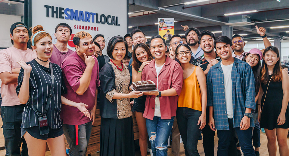 Group photo of Senior Minister of State Sim Ann with the cast and crew of FilterSpell from TheSmartLocal and Night Owl Cinematics.